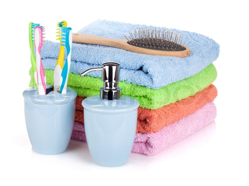 5746757-four-toothbrushes-liquid-soap-hairbrush-and-colorful-towels